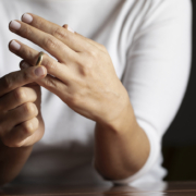 Woman taking off her wedding ring after finding out her spouse cheated.